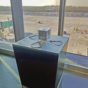 QUBE device charging at Manchester Airport