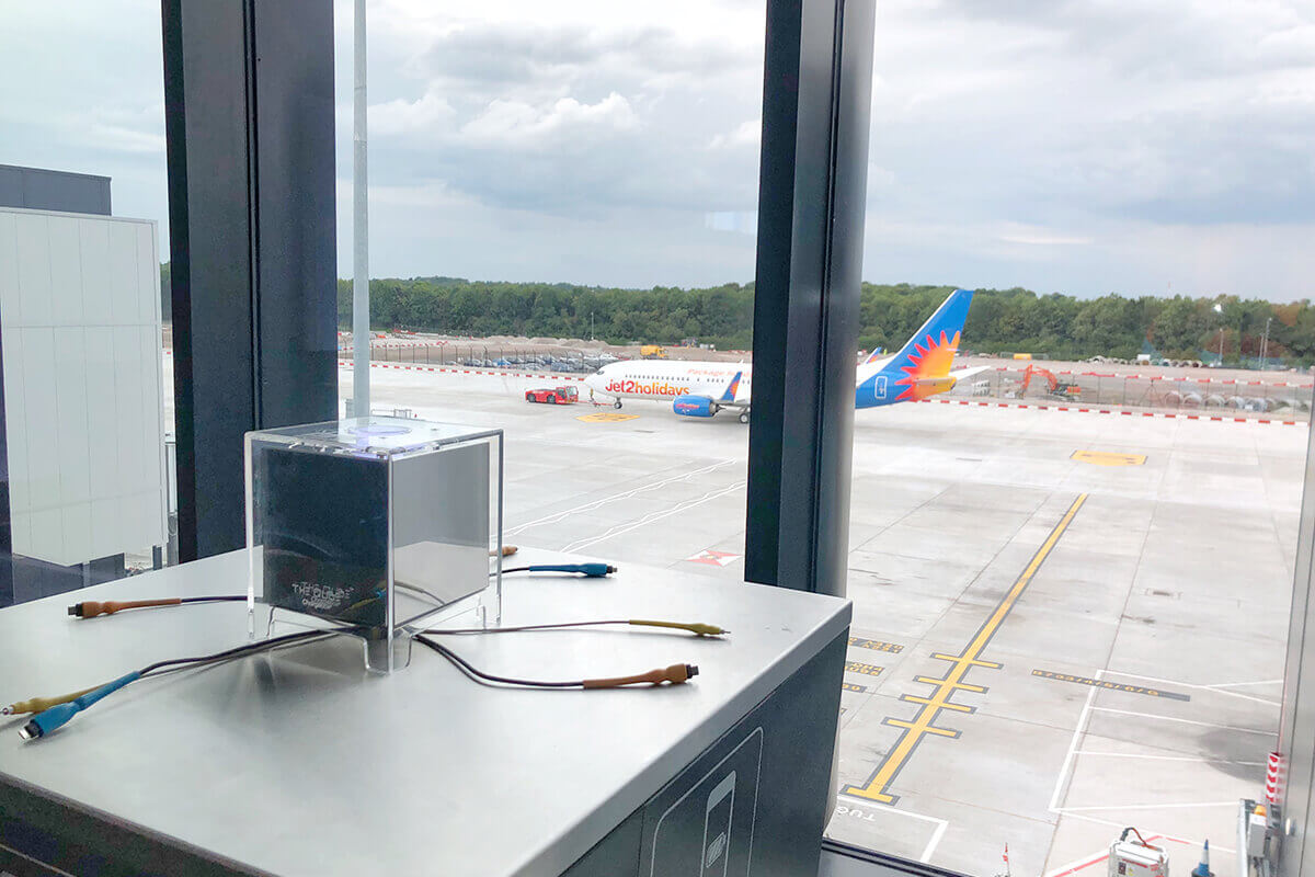 The QUBE table top charging at Manchester Airport